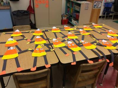 Pompom painting was used to paint the candy corns. The students then made candy corn people.